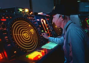 960130-N-2302H-001 	A U.S. Navy air traffic controller watches his radar scope where he works as an Aircraft Approach Controller in the Carrier Air Traffic Control Center on board the USS George Washington (CVN 73) on Jan. 30, 1996. The controller is responsible for ensuring the safe, orderly and expeditious flow of air traffic operating in the vicinity of the aircraft carrier. The nuclear powered aircraft carrier and its battle group are en route to the Mediterranean Sea for a scheduled six-month deployment.  While there, they will patrol the waters of the Adriatic Sea in support of the NATO Implementation Force (IFOR) in Operation Joint Endeavor.  DoD photo by Airman Joe Hendricks, U.S. Navy.